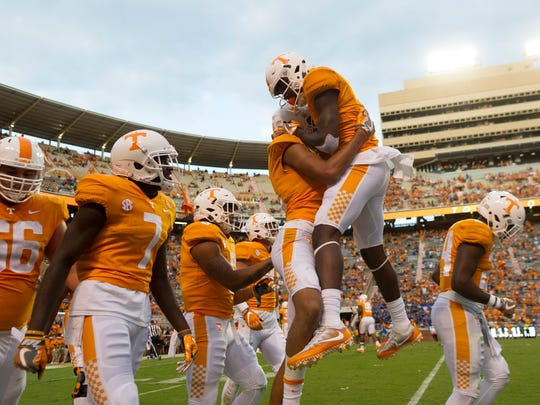 Vols wide receivers Jeff George (19) and  Jordan Murphy (11) celebrate George's touchdown against Indiana State on Saturday, Sept. 9, 2017.