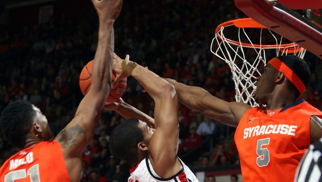 Former Rutgers basketball player Derrick Randall settled a lawsuit against the school stemming from former coach Mike Rice's actions for $300,000.