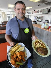Harvey Russell, owner of The Cafe in Prattville, cooks