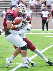 Aggies defensive back Malik Demby puts a vicious hit on NMSU tight end Clayton Granch that caused Granch to fumble.
