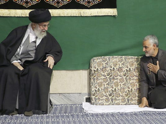 Commander of Iran's Quds Force, Qassem Soleimani, right, greets Supreme Leader Ayatollah Ali Khamenei while attending a religious ceremony in a mosque Friday at his residence in Tehran, Iran.