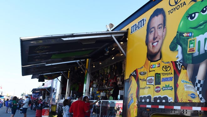 Fans peruse items at the merchandise trailer for  Kyle Busch before the 2015 Daytona 500.