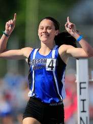 Ellie Friesen of Crestwood wins the 3A girls 3000 at