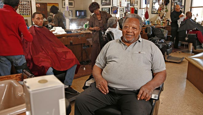George Greathouse on his last day of work before his retirement at the Esquire barbershop on December 31, 2015