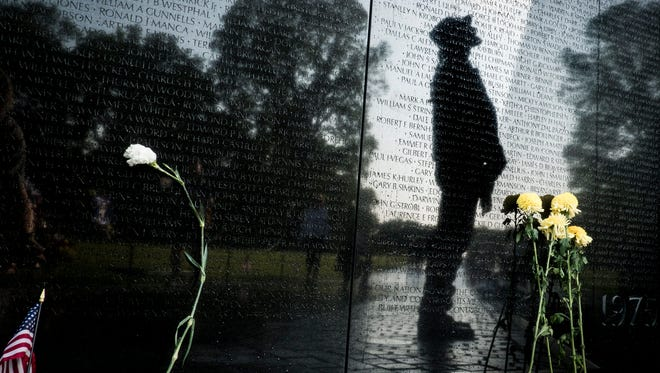 epa05996460 Rolling Thunder participant, Martin Jester, 76 of Daytona Florida, USA, searches for a fallen comrade on the Vietnam Veterans Memorial in Washington, DC, USA on 28 May 2017. Rolling Thunder Inc. is a non-profit organization dedicated to the search of American soldiers who are prisoners of war or missing in action. Rolling Thunder was established in 1987.  EPA/PETE MAROVICH ORG XMIT: PM1665