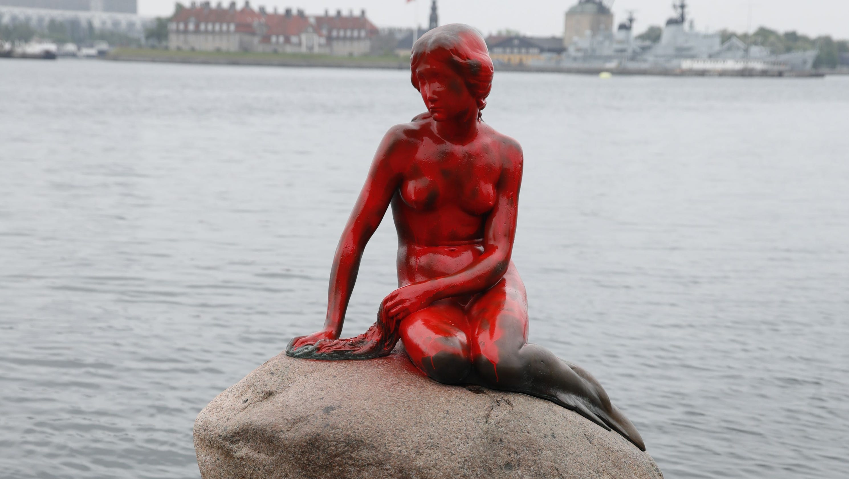 little mermaid statue in denmark painted red in whale