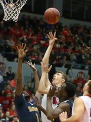 Fairport's Ryan Algier puts up a shot over University