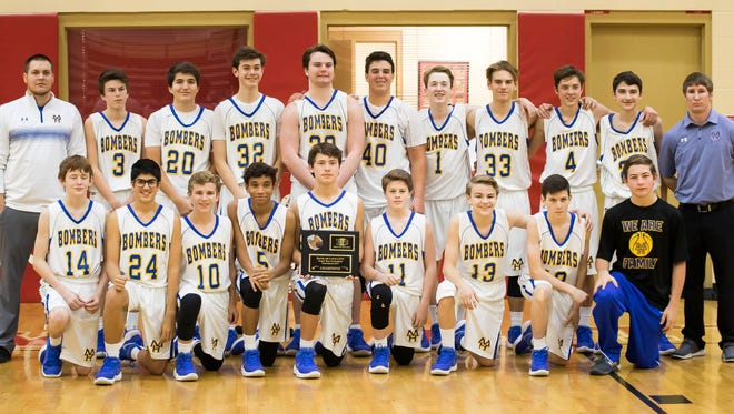 The Mountain Home Junior Bombers edged Southside Batesville in double overtime to win the Cave City Invitational on Wednesday night. The team, coached by Cody Wilmath and Calvin Henry, takes a 13-1 record into Christmas break.