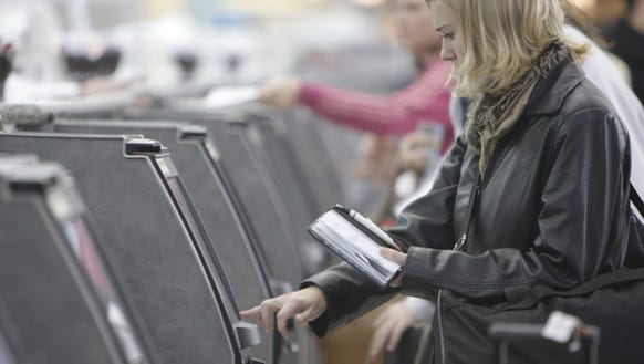 A traveler checks in for her flight at an American