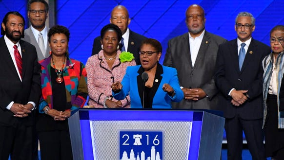 Rep. Karen Bass, D-Calif., speaks on stage while standing