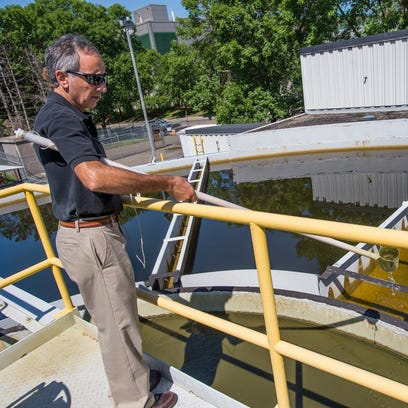 Paul Speranza, director of environmental services at i3 Electronics, stands at the edge of an equalization tank at the company's water treatment plant in Endicott during a tour of the facilities on Wednesday, August 24, 2016. Landfill leachate is treated for metals and other hazardous substances at the plant and discharged as effluent into the Susquehanna River.