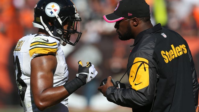 Steelers head coach Mike Tomlin talks with free safety Mike Mitchell on Oct. 12.