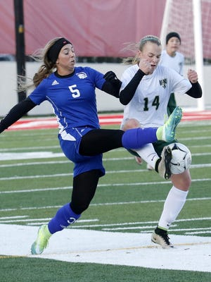 Genna Michitti, left, of Maine-Endwell and Vestal's Zoee Farr battle for possession Friday during the Section 4 Class A girls soccer championship game at Waverly Memorial Stadium.