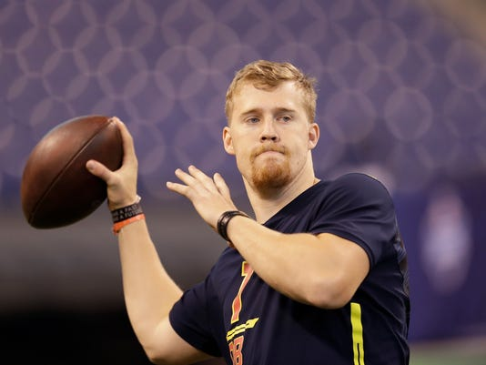 "FILE - In this March 4, 2017 file photo, Iowa quarterback C.J. Beathard runs a drill at the NFL football scouting combine in Indianapolis. Beathard said at times it was frustrating watching other quarterbacks put up more prolific numbers but the tutelage he received in a pro-style offense under coach Kirk Ferentz and coordinator Greg Davis is what made him attractive to the San Francisco 49ers in the draft last week. ""I think it really benefited me coming from a pro-style offense,"" Beathard said Thursday, May 4, 2017, on the eve of his first practice as a pro. (AP Photo/David J. Phillip, File)"