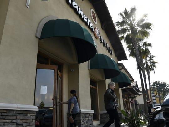 Customers come and go outside Visalia's Panera Bread,