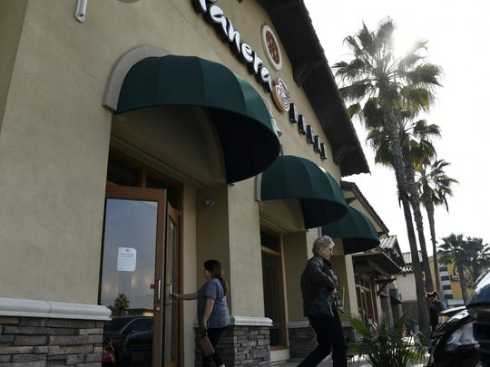 Customers come and go outside Visalia's Panera Bread, located on Mooney Boulevard, on Monday morning.