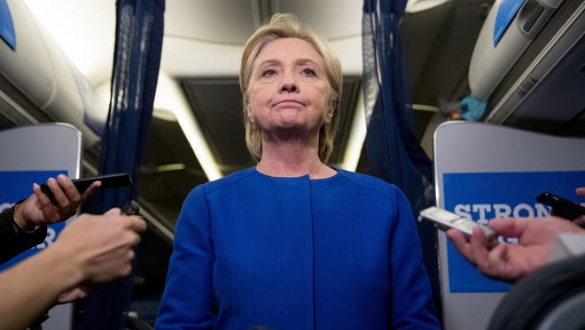 Democratic presidential candidate Hillary Clinton pauses while she gives remarks on the explosion in Manhattan's Chelsea neighborhood onboard her campaign plane at Westchester County Airport, in White Plains, N.Y., Saturday.
