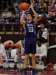 Wylie's Thomas Lynch (33) take a 3-pointer during the
