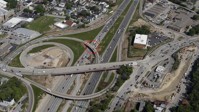 Aerial view of the I-75/Hopple Street exit, bottom photographed looking north to the I-75/I-74 interchange, top,  Wednesday May 15, 2013. The circle highlights the section of the flyover that collapsed on the I-75 southbound lanes Monday night.