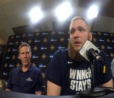 Gonzaga's Przemek Karnowski, right, speaks as head coach Mark Few looks on during a news conference for the Final Four NCAA college basketball tournament, Sunday, April 2, 2017, in Glendale, Ariz. (AP Photo/Tim Donnelly)