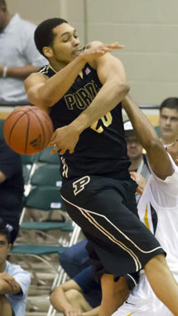Purdue center A.J. Hammons, shown here blocking a shot