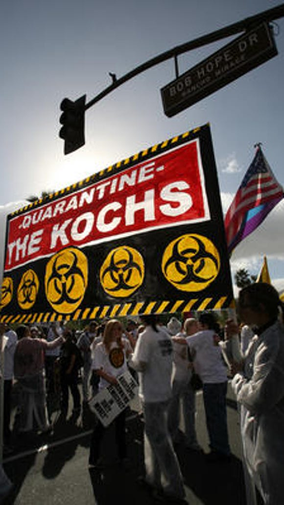 A protest at one of Koch brothers gatherings in Palm