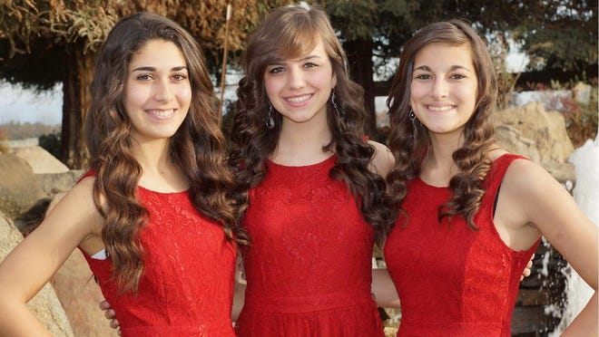 Tulare Senior Queen Marissa Lopes, center, and her attendants, Makayla Mendonca, left, and Caitlynn Toste.