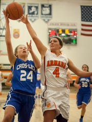 Cros-Lex sophomore Calli Townsend goes for a shot and is blocked by Armada senior Caitlyn Carlson during a basketball game Friday, Feb. 20, 2015 at Armada High School.
