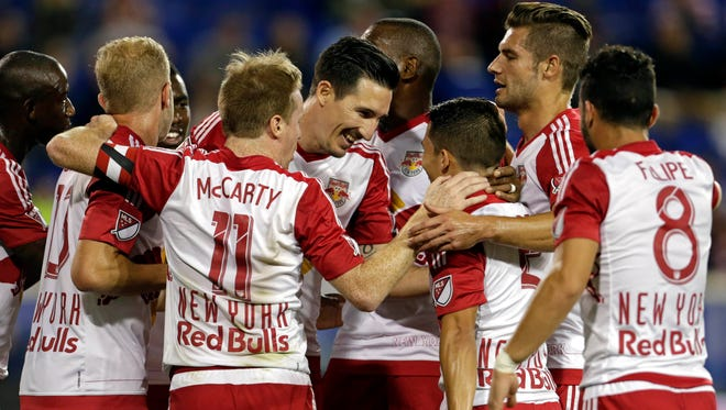 New York Red Bulls midfielder Sacha Kljestan is congratulated by teammates after scoring a penalty kick goal against the Montreal Impact.