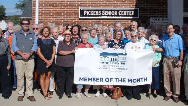 Shown is Liza Holder, board president of the Greater Pickens Chamber of Commerce, third from left, and the many members and supporters of the Pickens Senior Center.
