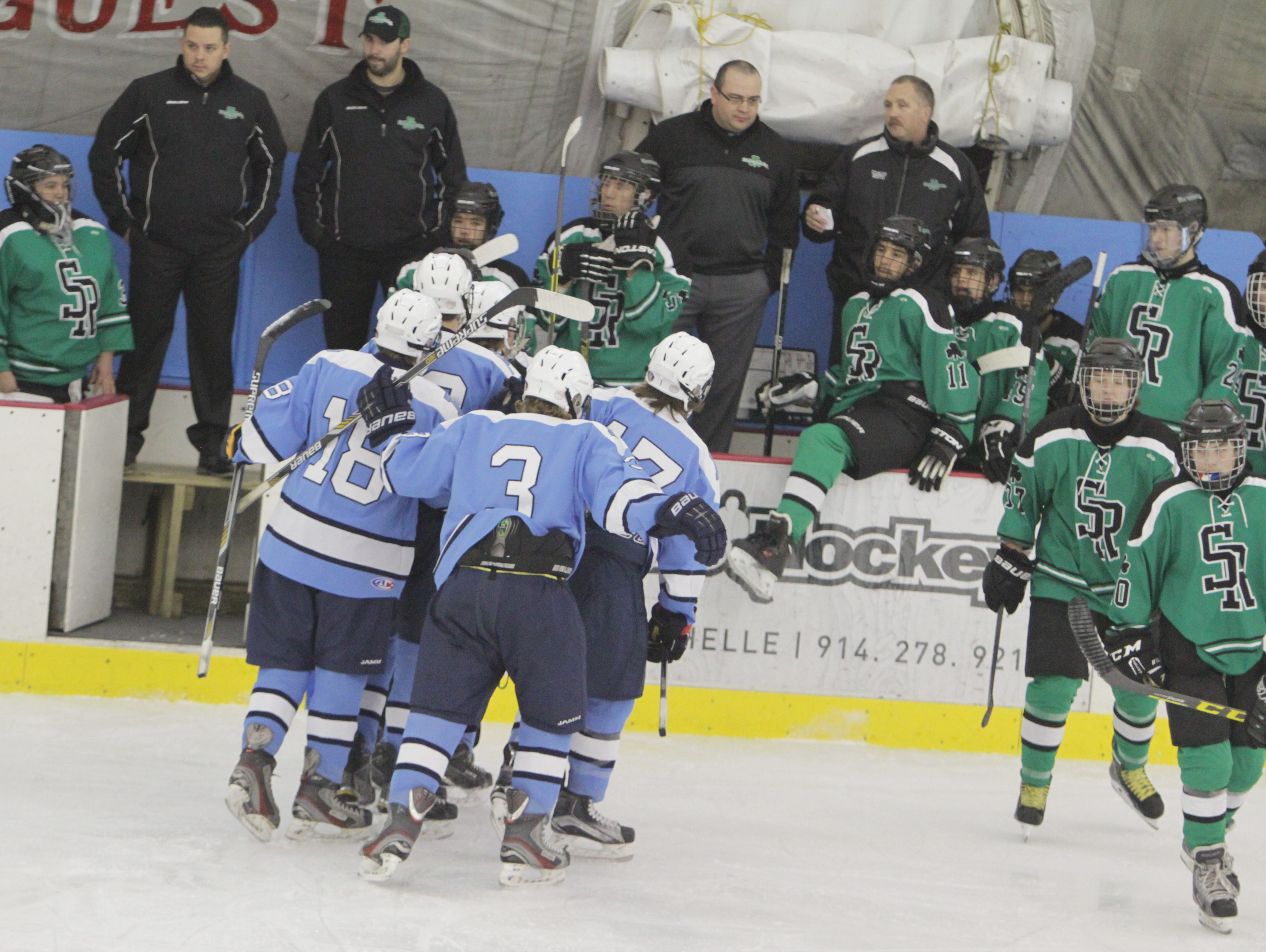 Pelham celebrates after Phil Dutko's goal to open the scoring in a game against Salmon River at the Ice Hutch in Mount Vernon on Friday, January 15th, 2016. Pelham won 8-0.