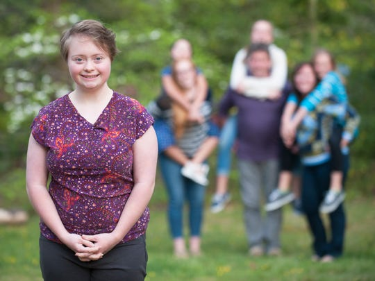 AnnaRose Rubright, 20,  who has appeared in public service announcements about what its like to have Down syndrome,  stands by her family on the front lawn of their Medford home.   05.10.16