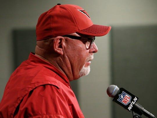 Cardinals head coach Bruce Arians speaks during a news