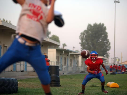 The Indio High School football team practice on Tuesday, August 18, 2015.
