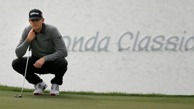 Feb 27, 2020; Palm Beach Gardens, Florida, USA; Brendan Steele waits to putt on the 18th green during the first round of the 2020 Honda Classic golf tournament at PGA National (Champion). Mandatory Credit: Reinhold Matay-USA TODAY Sports