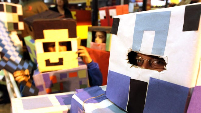 Michael Piscopo, 9, Toms River, peeks out from his Minecraft costume in the Toms River Halloween Parade Saturday night, oCtober 25, 2014.    TOMS RIVER, NJ  TRPARADE1025C  ASB 1026 Toms River Halloween Parade  STAFF PHOTO BY THOMAS P. COSTELLO / ASBURY PARK PRESS