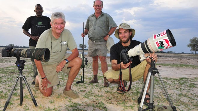 Brent Stapelkamp, front right, researches lions with his colleagues in Zimbabwe's Hwange National Park.