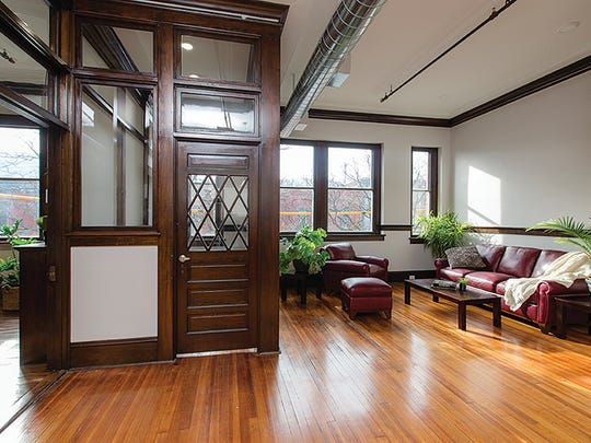The original office for the Hawkes Glass Co. has been converted to an apartment that shows original trim, floor, ceilings and windows.