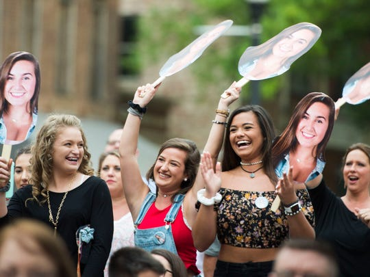 At right Chloe Sherrod and to her left Kelly Dunlap cheer on their friend Emma Cannon at the CTE goes Live performance in Market Square Friday, May 4, 2018.
