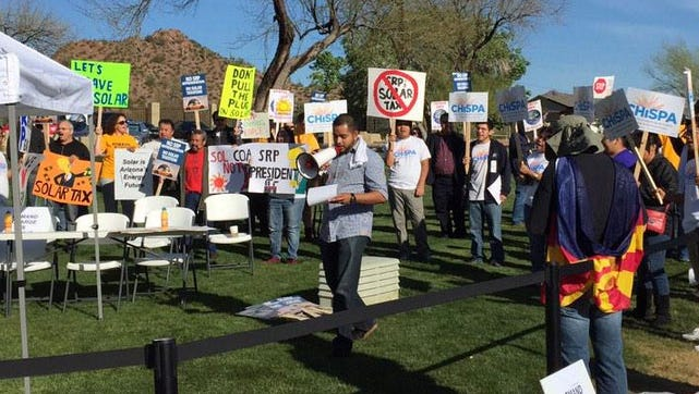 Protesters at Salt River Project's meeting.