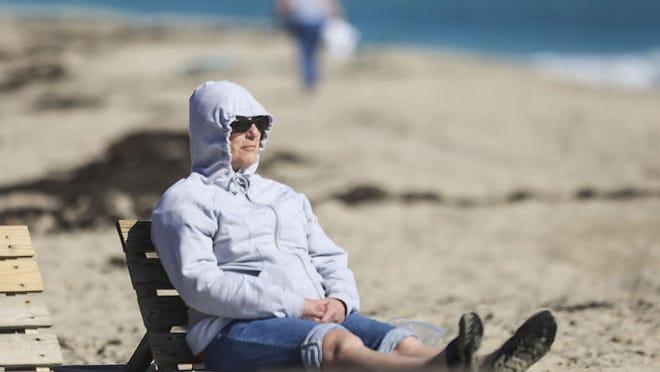 Vacationing from Milwaukee, Marianne Evert, at Lake Worth Beach.