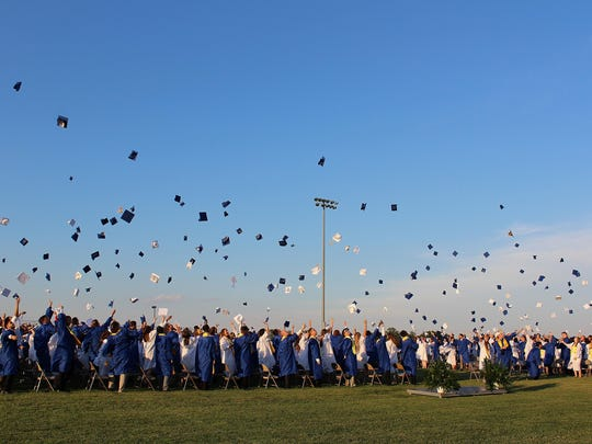 Hammonton High School's Class of 2017 toss their caps into the air after turning their tassels on June 20.