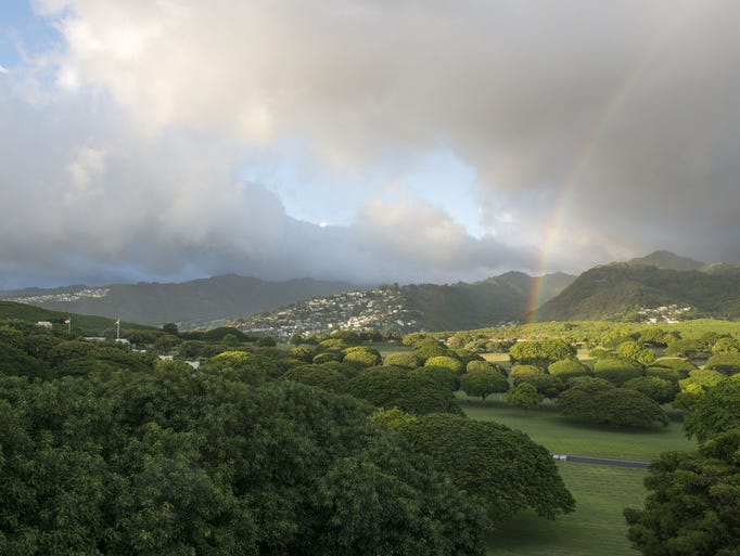 A rainbow appears over Punchbowl Crater at the National