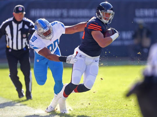Chicago Bears tight end Daniel Brown is tackled by Detroit Lions defensive end Cornelius Washington during the first quarter at Soldier Field.