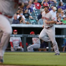 DENVER, CO - AUGUST 14:  Ryan Ludwick #48 of the Cincinnati Reds heads home to score on a single by Zack Cozart #2 of the Cincinnati Reds to give the Reds a 2-0 lead over the Colorado Rockies in the second inning at Coors Field on August 14, 2014 in Denver, Colorado.  (Photo by Doug Pensinger/Getty Images)