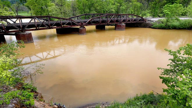 In this May 22 photo, sludge from the Hi-Crush mine in Whitehall, Wis., is seen in the Trempealeau River near Dodge. A contractor's bulldozer slid into a pond earlier this week, leading to an hours-long rescue at the Hi-Crush mine.