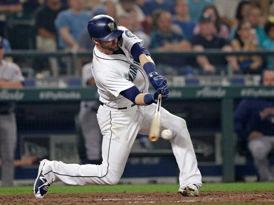 Seattle Mariners' Mike Zunino doubles in a run against the Houston Astros in the fourth inning of a baseball game, Monday, Aug. 20, 2018, in Seattle. (AP Photo/Elaine Thompson)