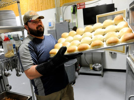 Lowake Steak House owner Kerry Goetz takes a sheet of rolls out of the oven Thursday Oct. 26, 2017. The restaurant moved in February from it's original 1951 location to a new site off U.S. 67 in Rowena.