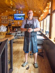 Owner Jamie Rozzi of Rozzi's Lakeshore Tavern in Colchester on Tuesday, July 25, 2017.