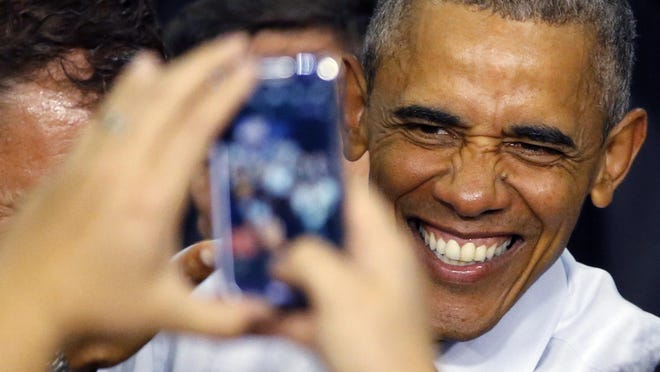President Barack Obama smiles for a photograph after addressing the crowd at the Concord Community High School Wednesday, June 1, 2016, in Elkhart, Ind. (AP Photo/Charles Rex Arbogast)